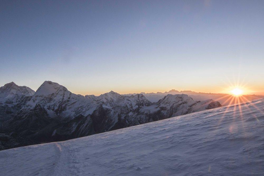 Sunrise at 21,000ft; Makalu on the far left. My photo.