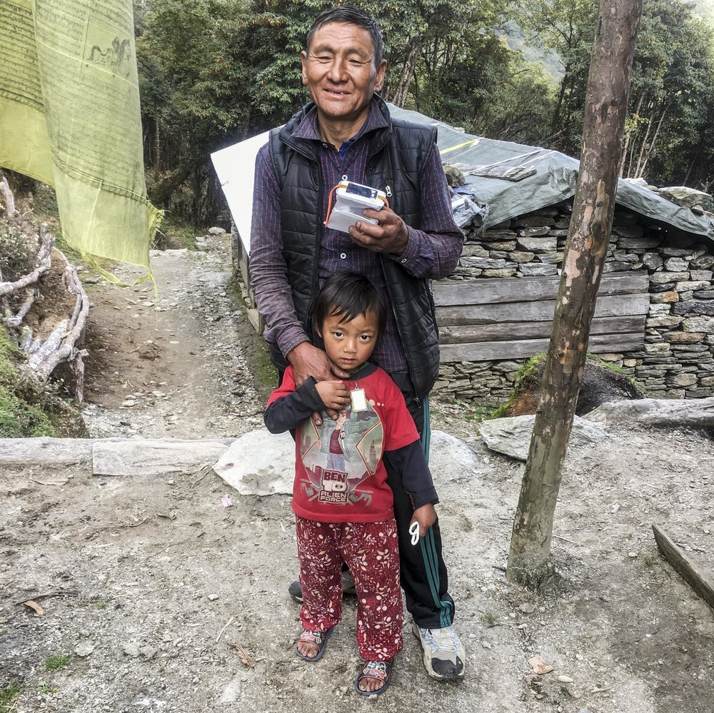 The first light recipients: father and son at the top of Panggom La Pass