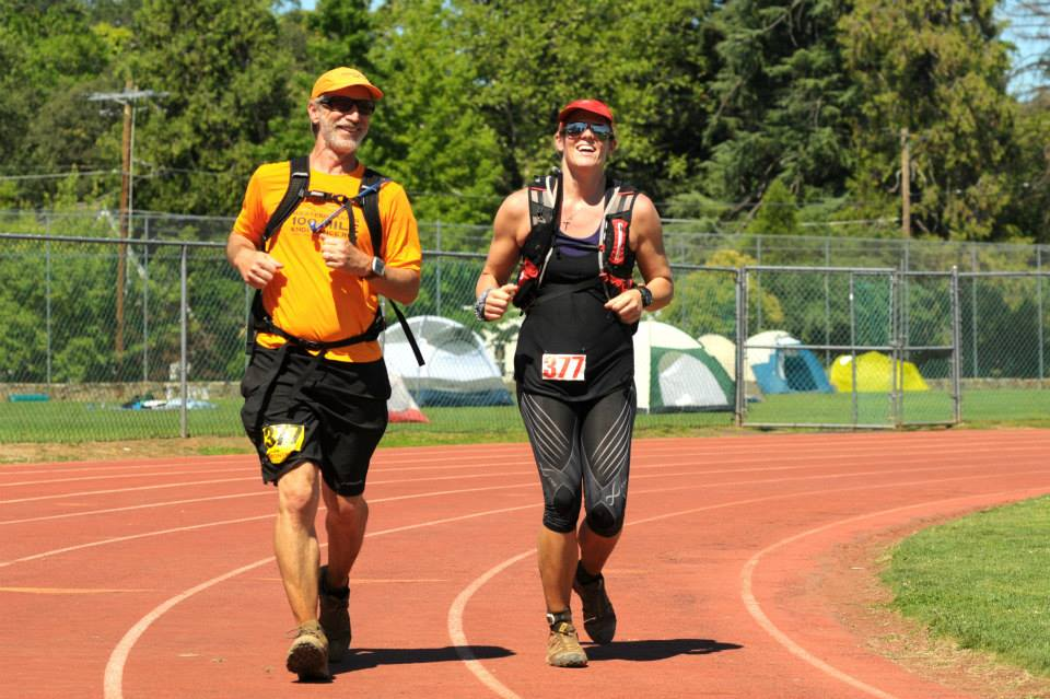 With my pacer and friend Mark Swanson on the final yards of Western States 2013 after running  100.2 miles.  Can you tell I was hurting? Running a 100 miler on <18 miles per week of training volume... possible but not recommended.