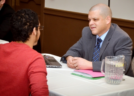 From left: Scholar Jarell Pryor meets with Jonathan Ouckama