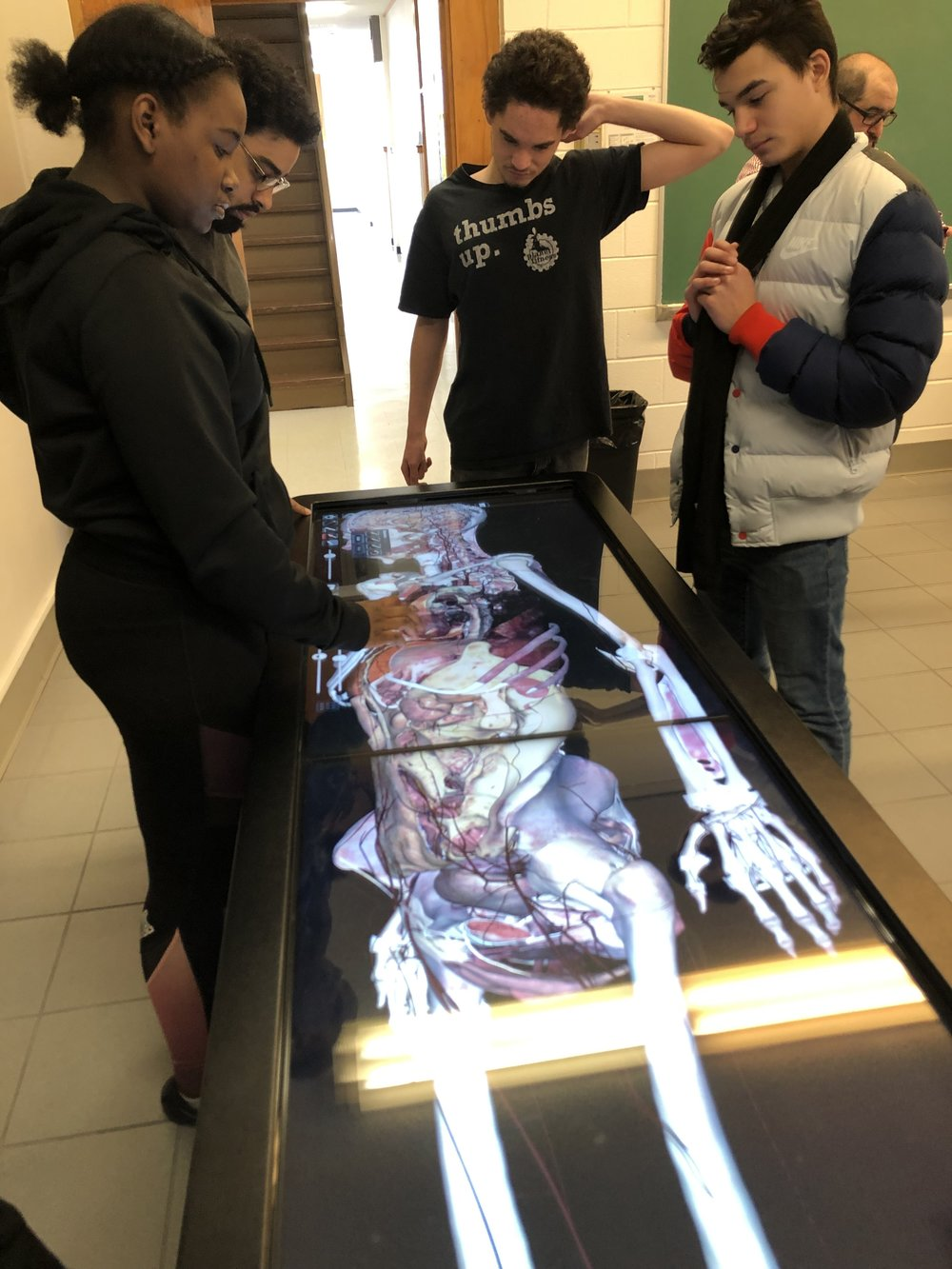 Exploring the anatomage tables at Maria College.