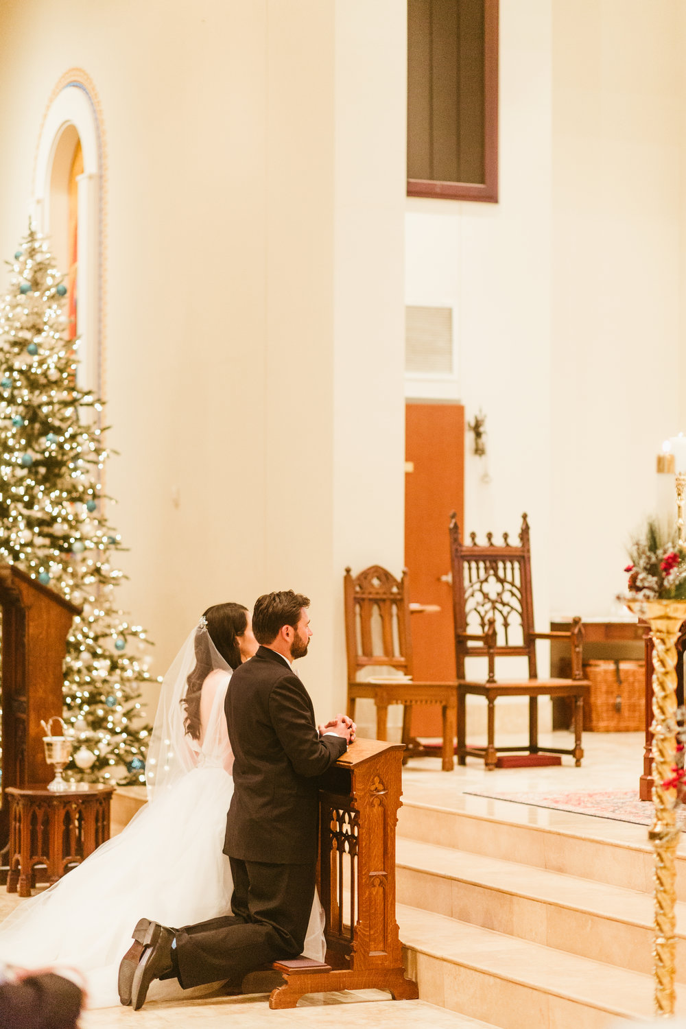 After receiving one undeserved gift (the Sacrament of Marriage) and preparing to receive the most undeserved gift (the Eucharist). Photo by  Leah Muse .