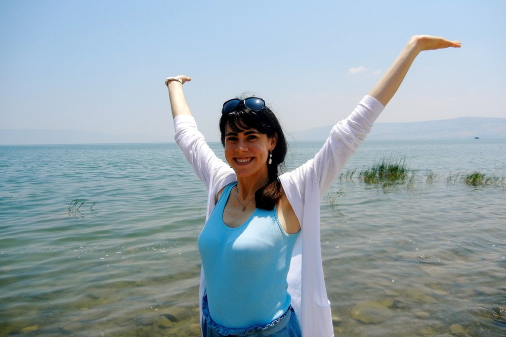 I did end up going to the Holy Land while I was single (this is me standing in the Sea of Galilee).  Highly recommended.