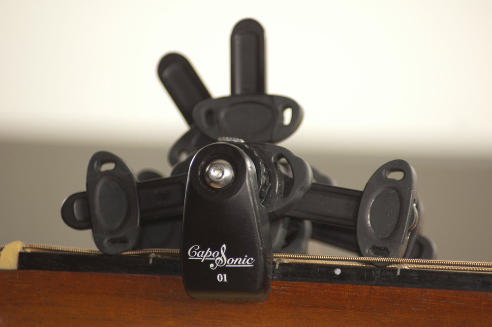 """CLOSE UP OF CAPOSONIC - """"SEE THE LOCKED-IN"""" ENGAGEMENT ON THE STRINGS"""