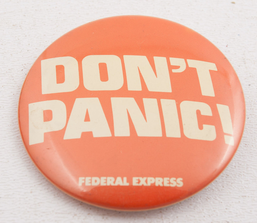 "Vintage federal express ""don't panic"" button, circa 1978"