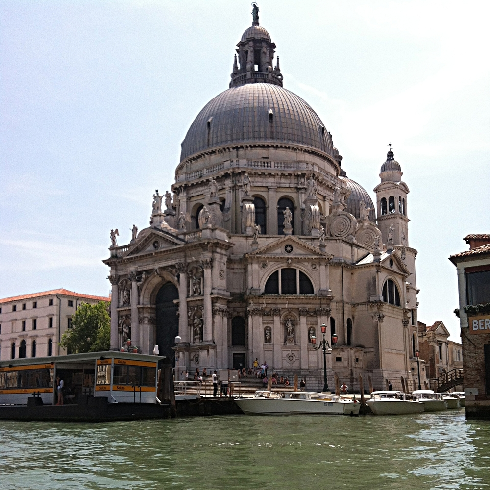 The beautiful architecture in Venice. Notice the water bus?