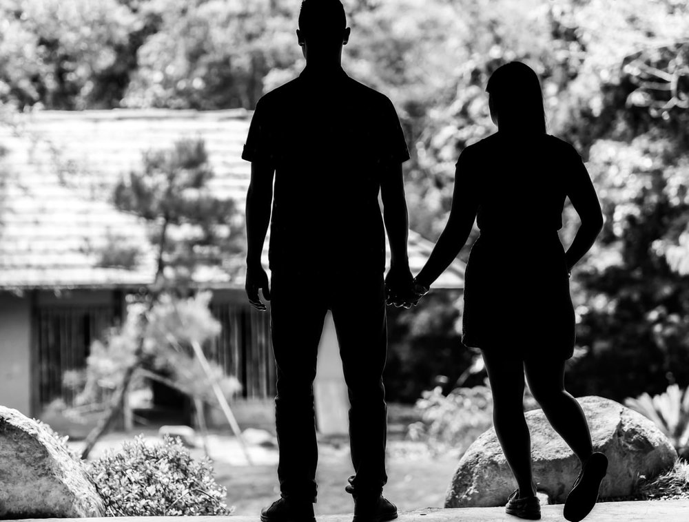 Silhouette of engaged couple holding hands during Costa Rica engagement photography session.