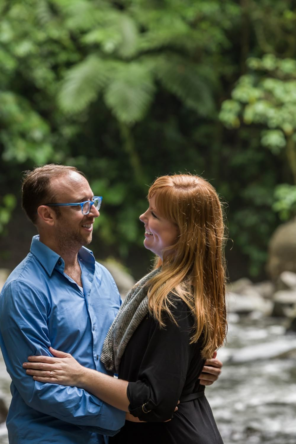 During engagement in Costa Rica, a just engaged couple smiles at