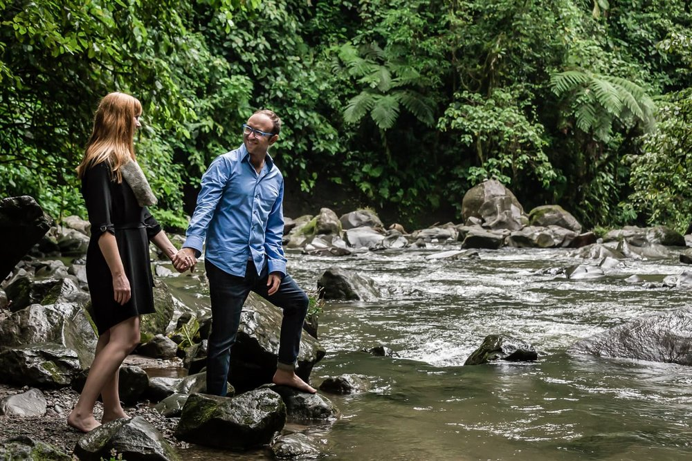 Photograph of couple getting engaged in Costa Rica by river at La Fortuna.