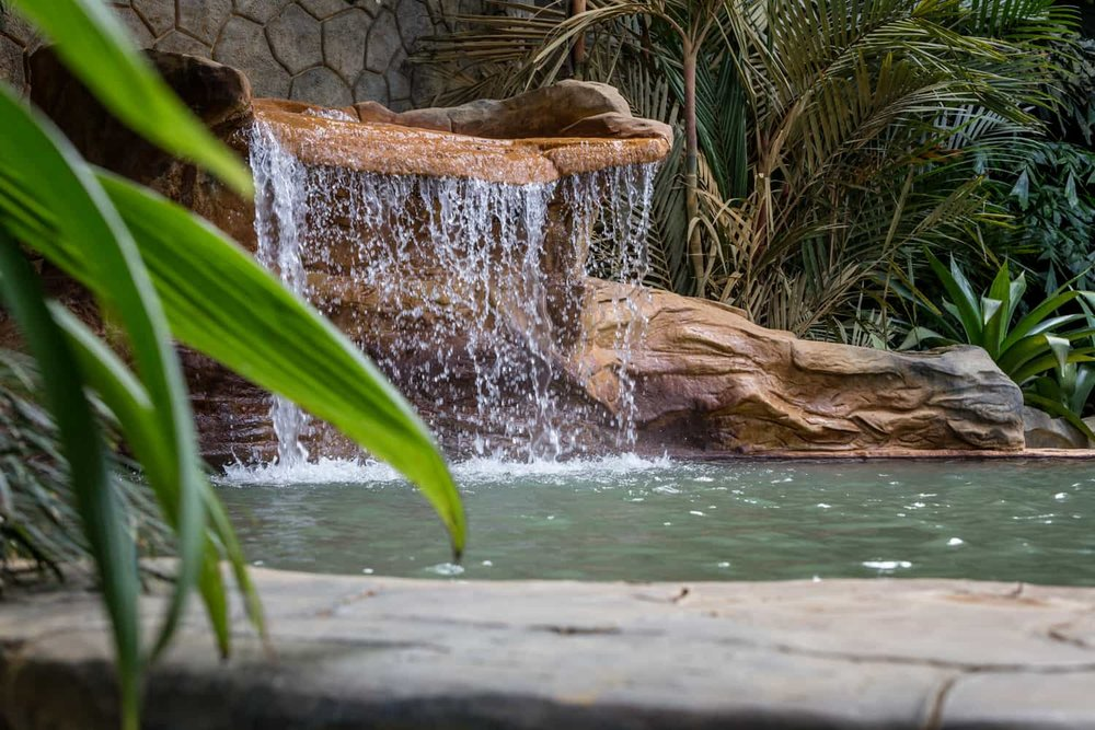 Photo of waterfall at thermal pool wedding ceremony location at Treetops.