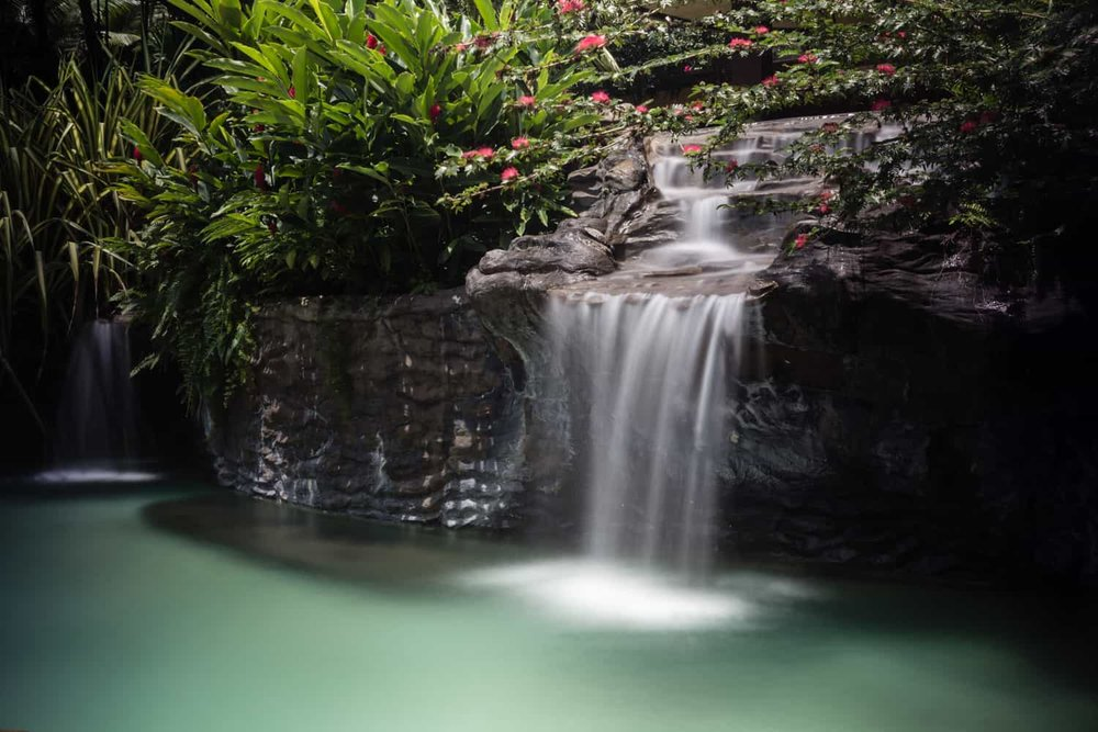 Long exposure of waterfall located near underwater bar at The Springs Resort & Spa in Arenal.