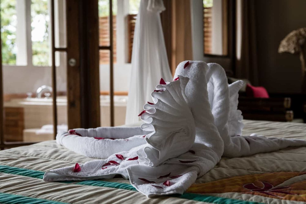White swans made from white towels on ben in Honeymoon Suite.