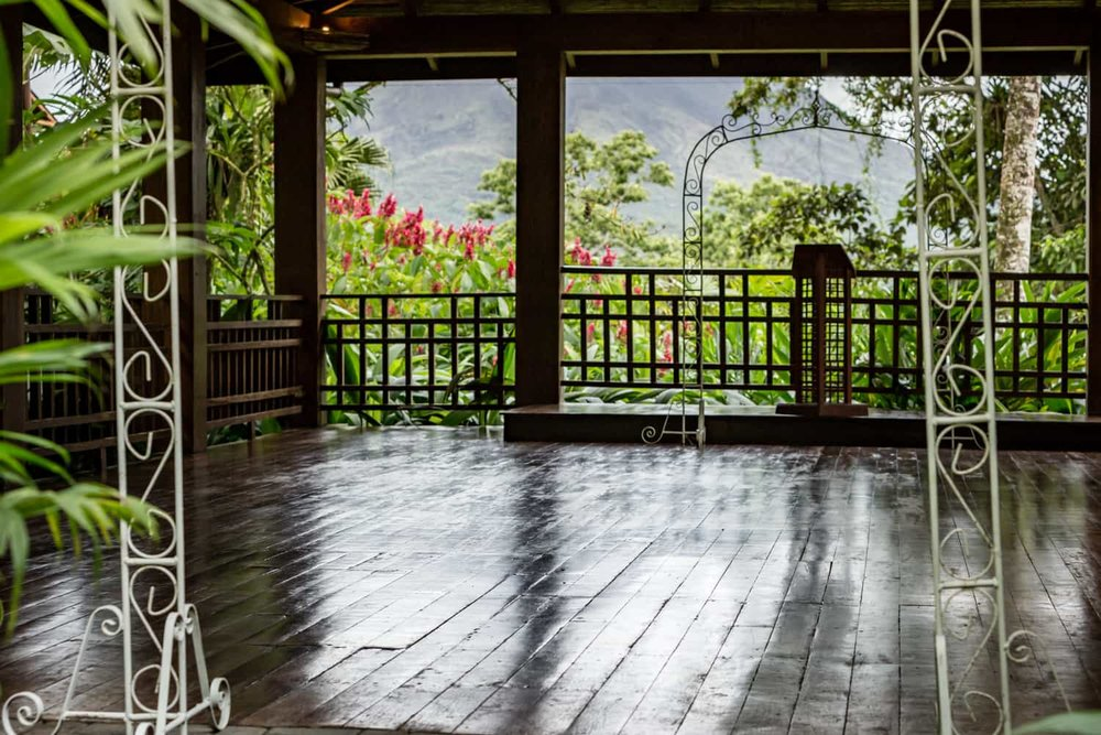 Photo of primary wedding ceremony location with view of Arenal Volcano.