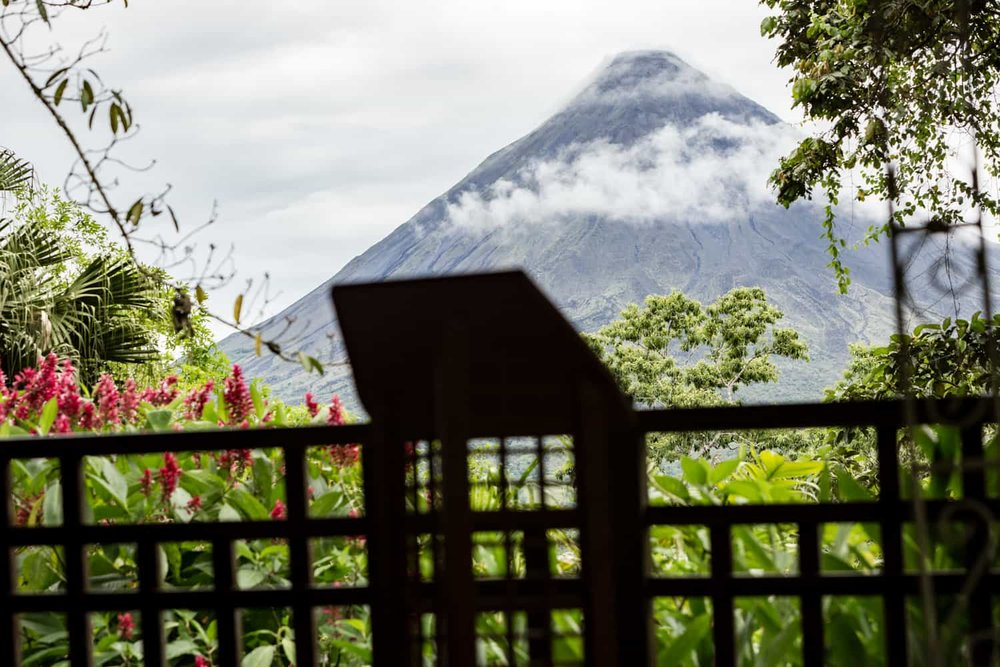 Photo of wedding ceremony altar in La Fortuna with Arenal Volcano in background.
