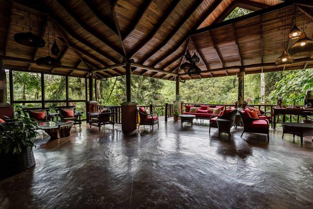 Main area in reception building at Lost Iguana Resort in La Fortuna.