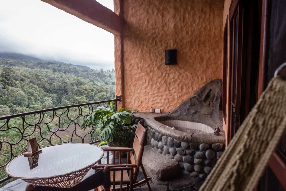 Hot tub on honeymoon suite balcony overlooking Costa Rica cloud forest.