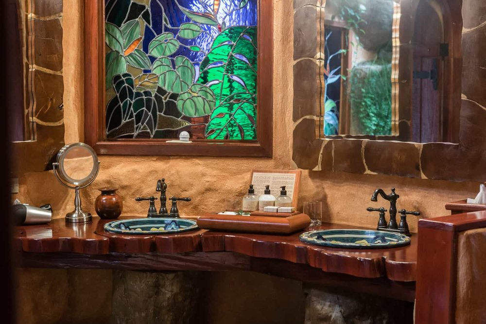 Bathroom vanity in honeymoon suite in garden inspired bathroom at Peace Lodge.