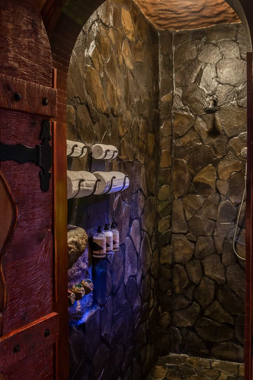 Exquisite natural stone shower in honeymoon suite bathroom at Peace Lodge.