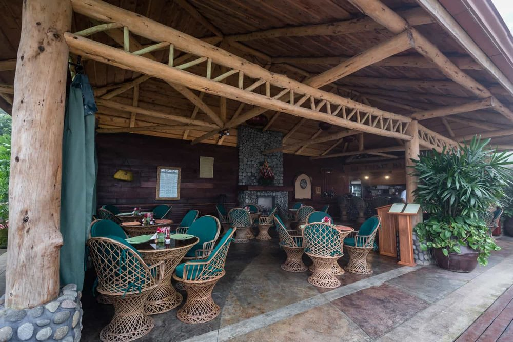 Covered seating area inside for wedding event at Peace Lodge bar.