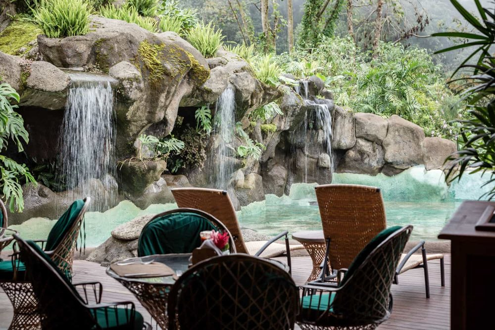Waterfalls in pool at Peace Lodge bar ideal for wedding receptions.