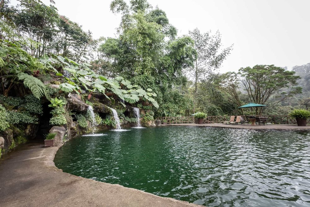 Pool waterfalls with Poas cloud forest in background at reception site.