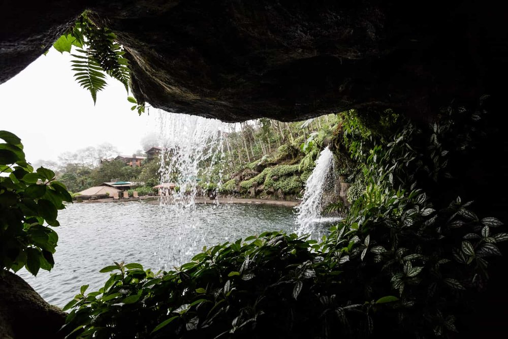 Photo of Peace Lodge wedding reception area from behind waterfall cavern.