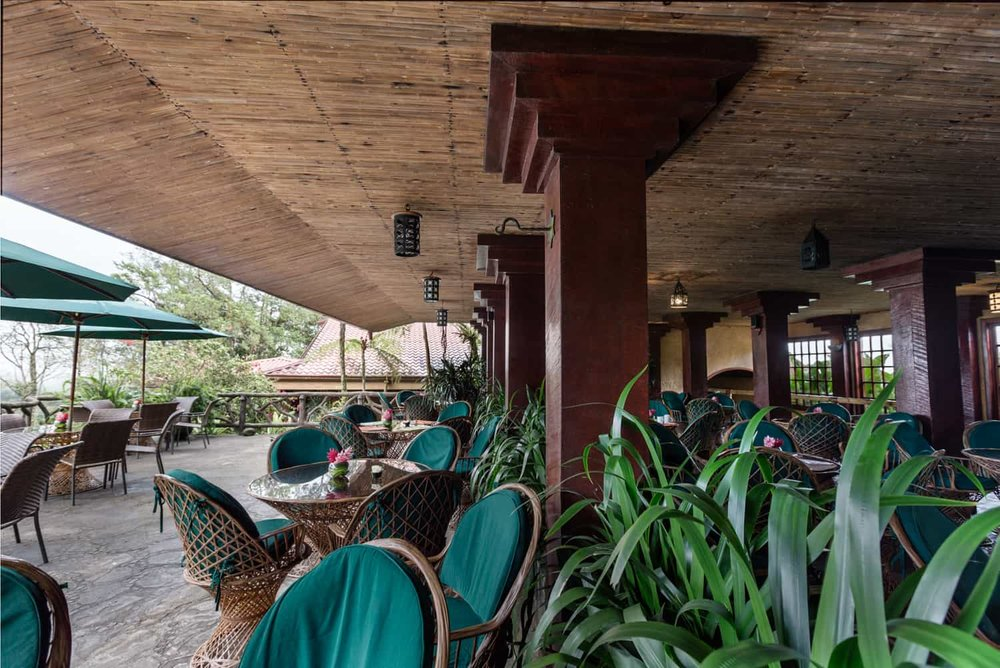 Seating area at front of restaurant with view of countryside.