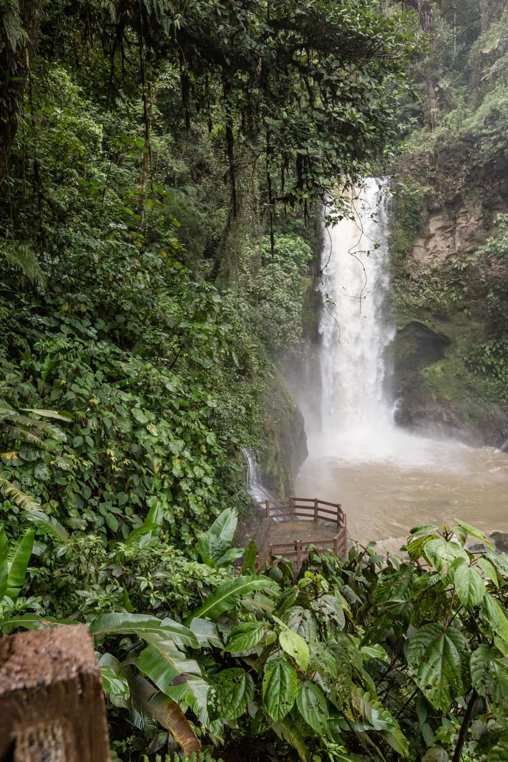 Terrace by waterfall at Peace Lodge for intimate weddings.