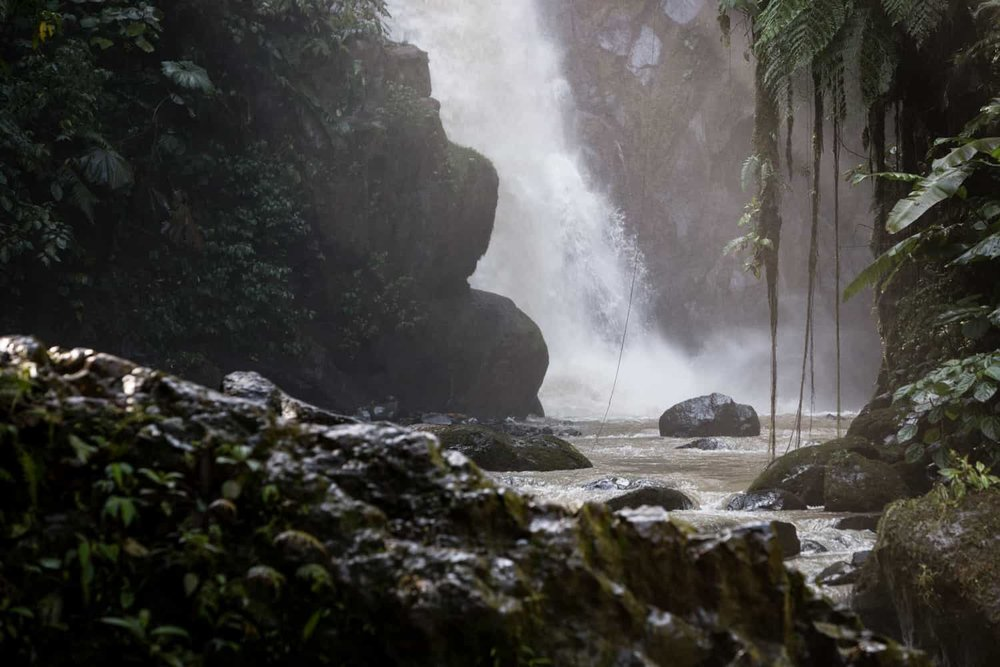 View of Magia Blanca Waterfall base from beach by river for getting married.