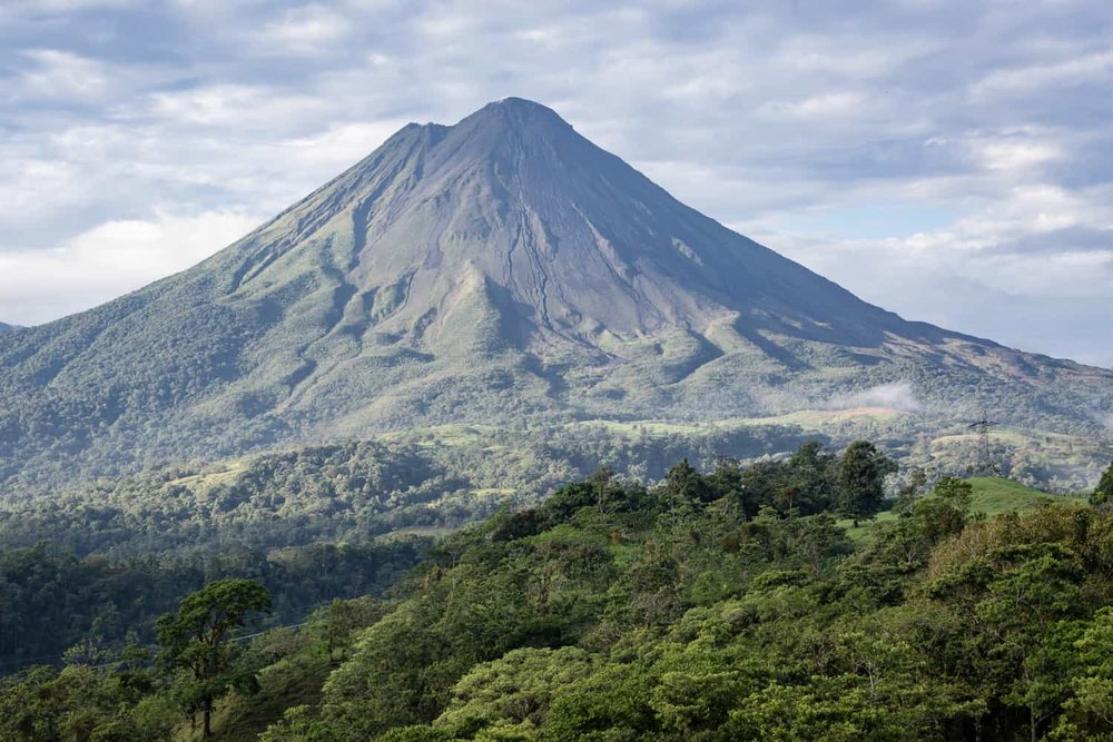 View the Arenal Volcano from from a hill near its base at a wedding venue in La Fortuna, Costa Rica.