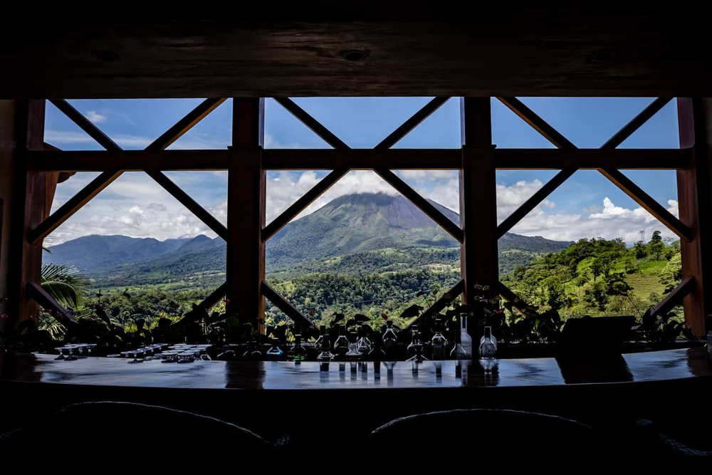 View of Areal Volcano from a bar in The Springs Resort & Spa Reception Building in La Fortuna.