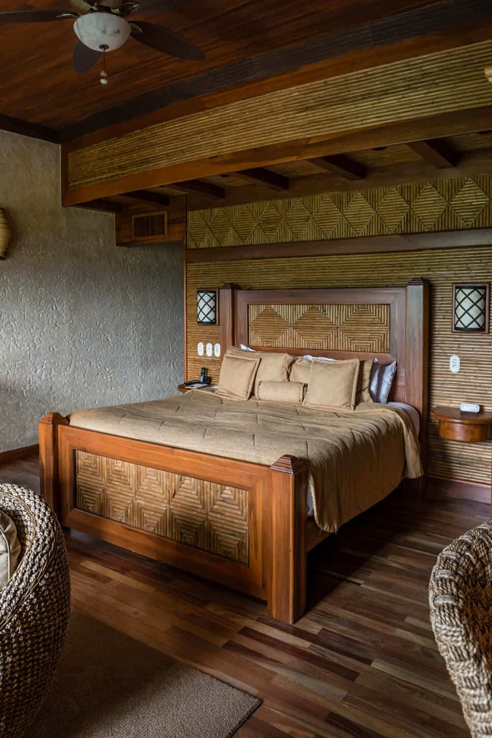 Honeymoon suite bedroom with wood floors and king-size bed.