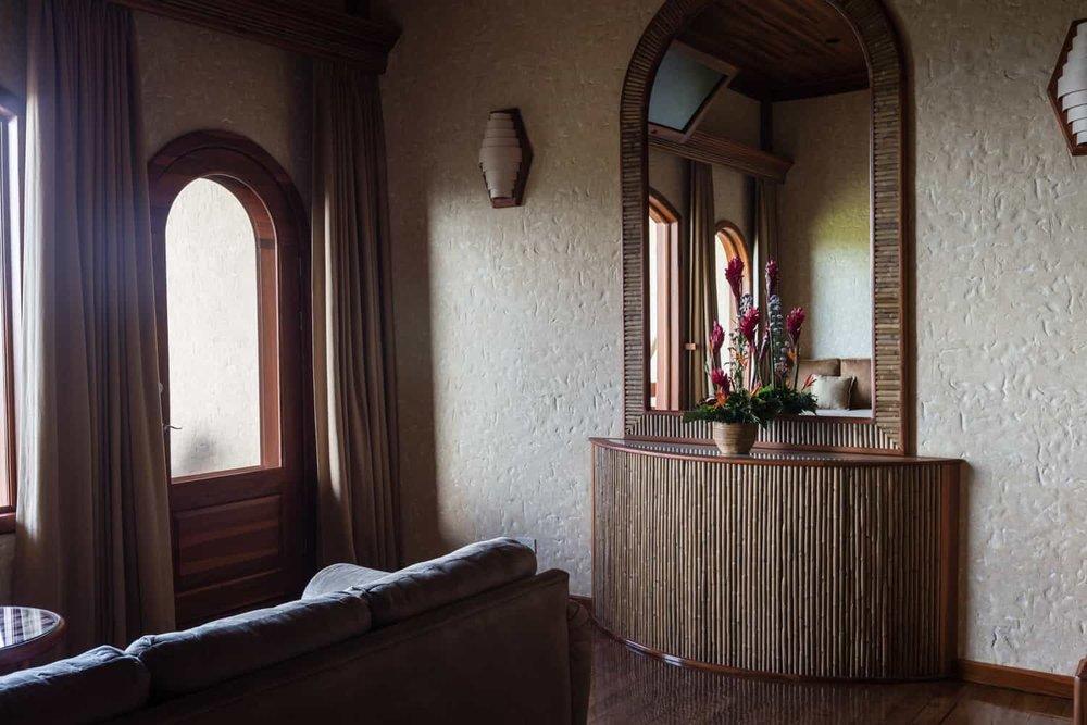 Door to balcony in bedroom in standard accommodations.