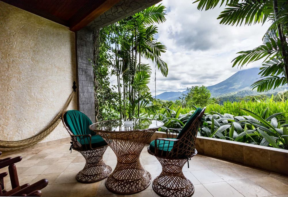 Balcony overlooking Arenal rainforest and volcano.
