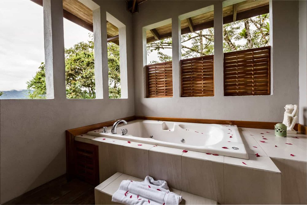 Gorgeous jacuzzi-type tub with view of Arenal Volcano in Lost Iguana Resort Honeymoon Suite.