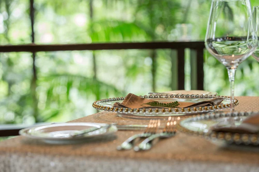 Close-up of silverware for newlywed dinner in tropical hut.