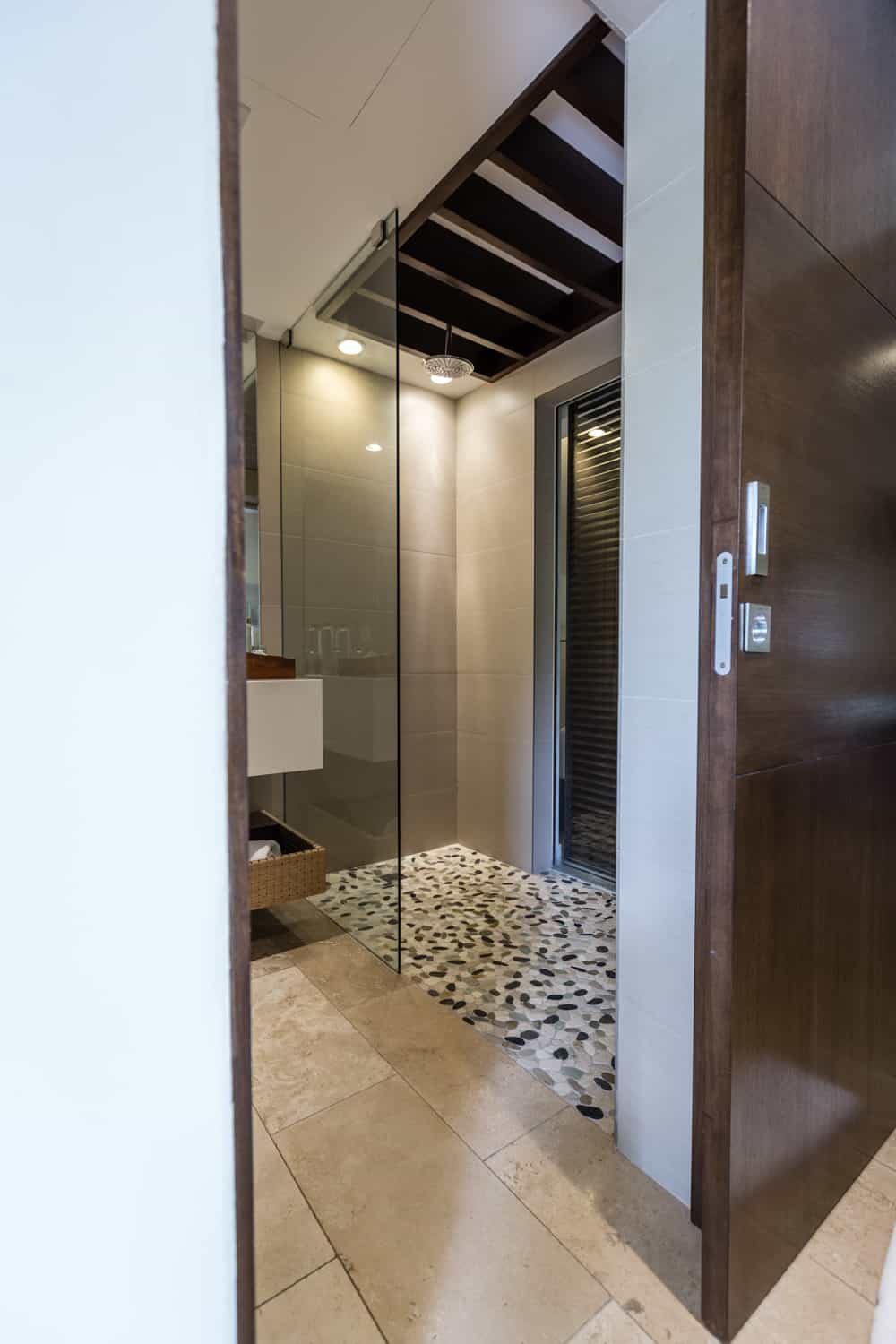 Elegant modern bathroom with solid wood sliding door.