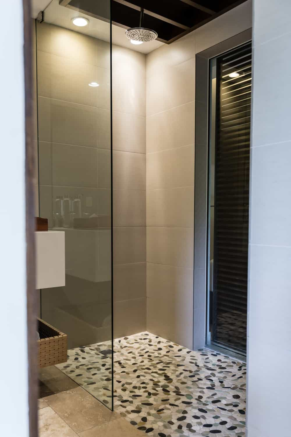 Luxury walk-in bathroom for wedding guests in Tabacon standard room.