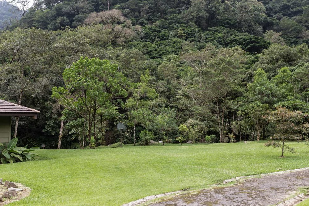Mountain bordering lawn at El Silencio Lodge is ideal for weddings.