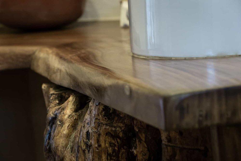 Beautiful wood vanity in luxury beach honeymoon suite.
