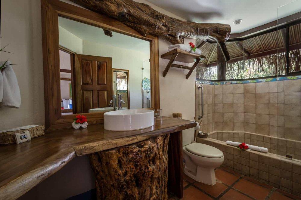 Rustic, modern bathroom in suite for honeymooners.