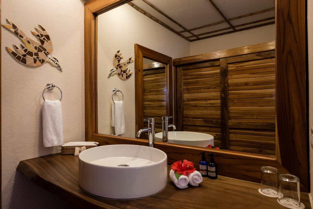 Hotel Punta Islita's deluxe room bathroom area.
