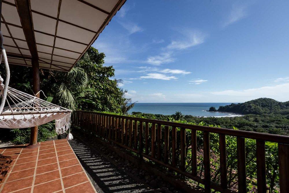 Deluxe room's terrace with hammock overlooking mountains & Pacific Ocean.