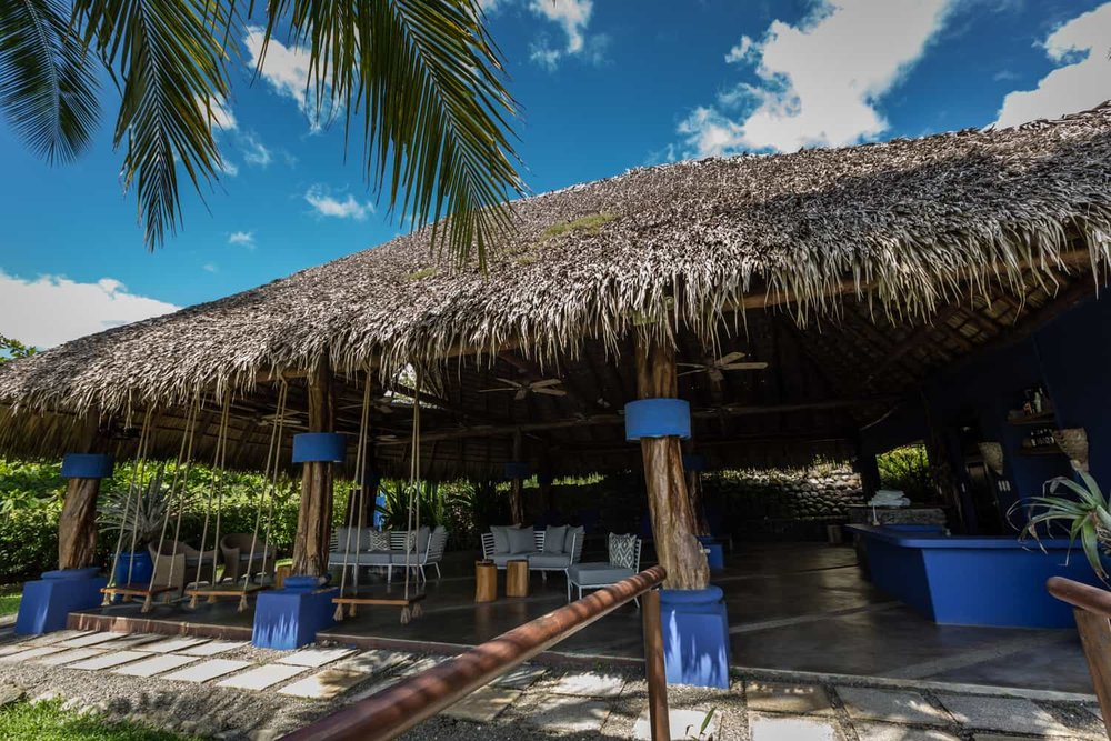 Beach restaurant with thatched room is great place for bead wedding reception.