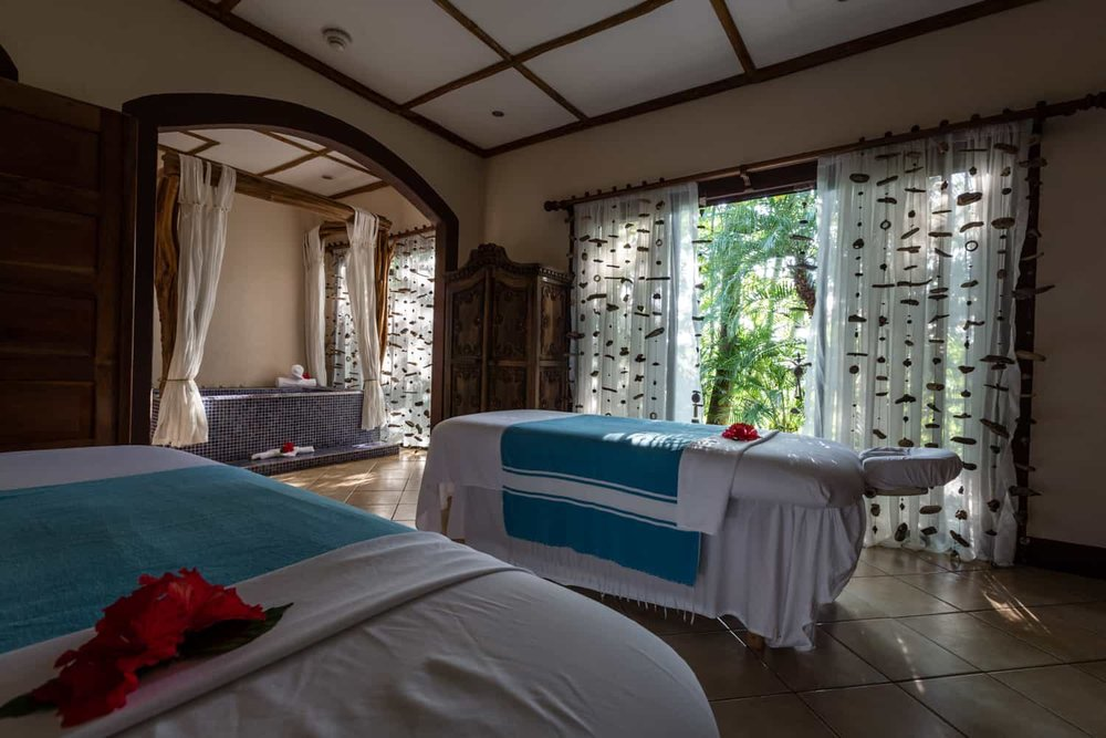 Large treatment room for couples with rainforest view.