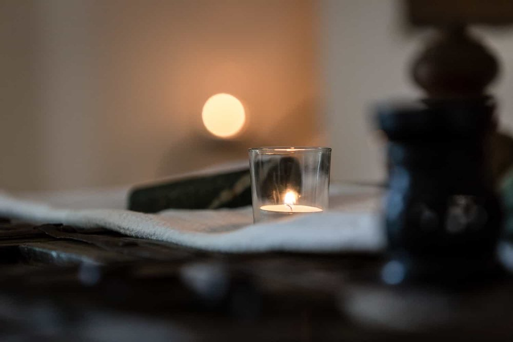 Candles for romantic ambiance in massage room for couples.