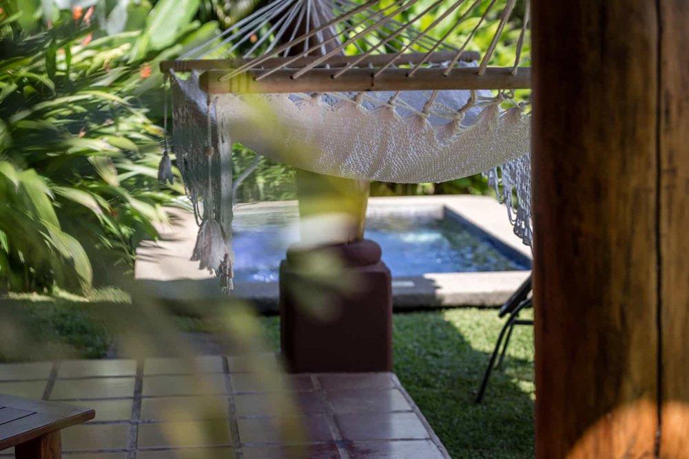 In-ground pool in rear area of Junior premium suite.