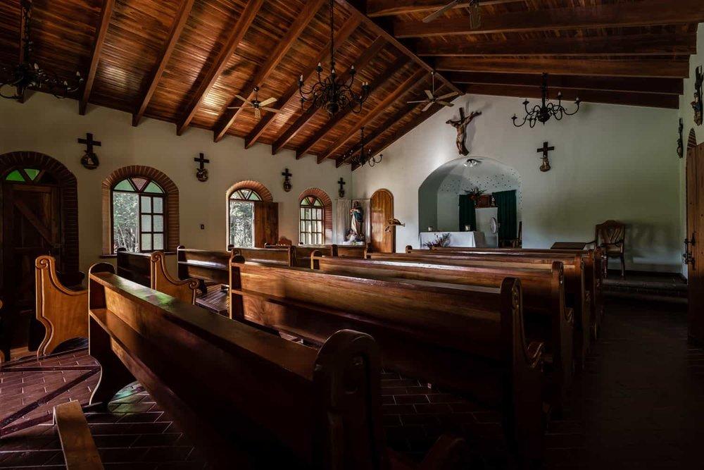 Photo of side windows in quant Catholic church in Punta Islita.