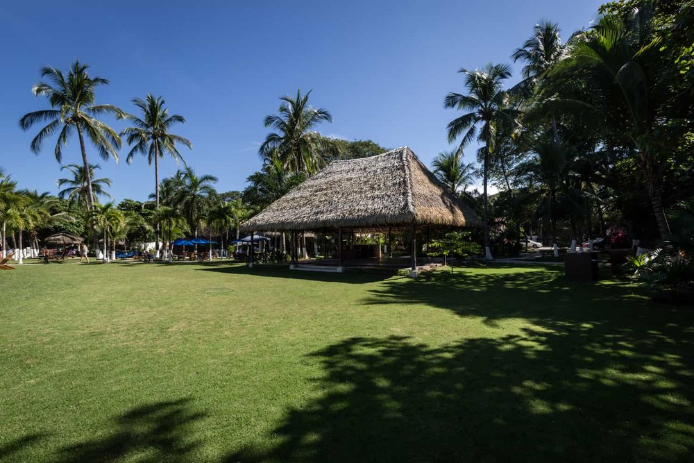 Beachfront lawn area for large Guanacaste wedding ceremony.