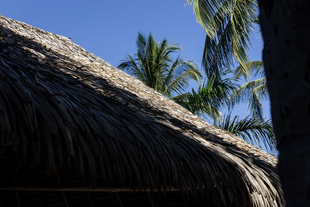 Thatched roof covering Bahia del Sol Hotel's beach wedding venue.